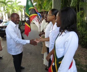 PM Douglas St.-Kittsgreets his country's students at ELAM