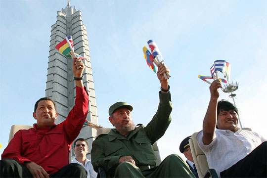 chavez fidel y evo with flags