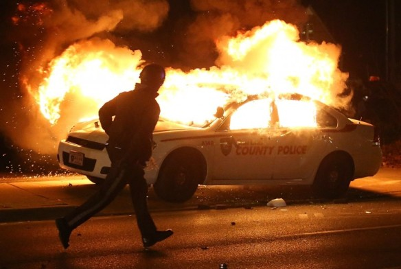 ferguson in flames country police car