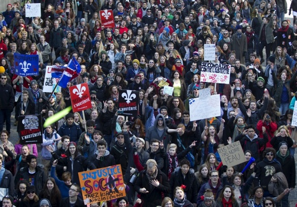 Thousands march during a student-led protest against the provincial government's austerity measures in Montreal