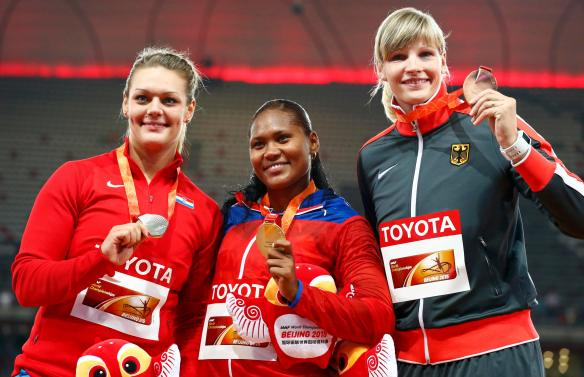 (L-R) Sandra Perkovic of Croatia, silver medal, Denia Caballero of Cuba, gold medal, and Nadine Muller of Germany, bronze medal, pose on the podium after the women's discus throw event during the 15th IAAF World Championships at the National Stadium in Beijing, China, August 25, 2015.       REUTERS/David Gray