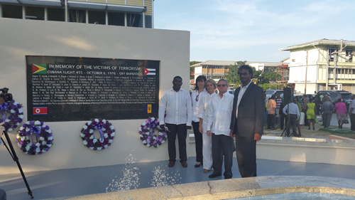 From Left:  President of Guyana-Cuba Solidarity Movement (GCSM) Haleem Khan and Ambassador Mr. Julio Cesar Gonsalez Marchante with family at the wreath laying ceremony