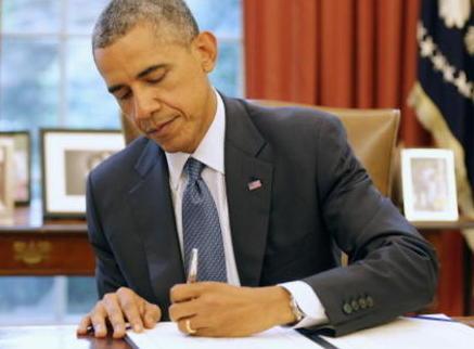 obama signs 2c.jpg